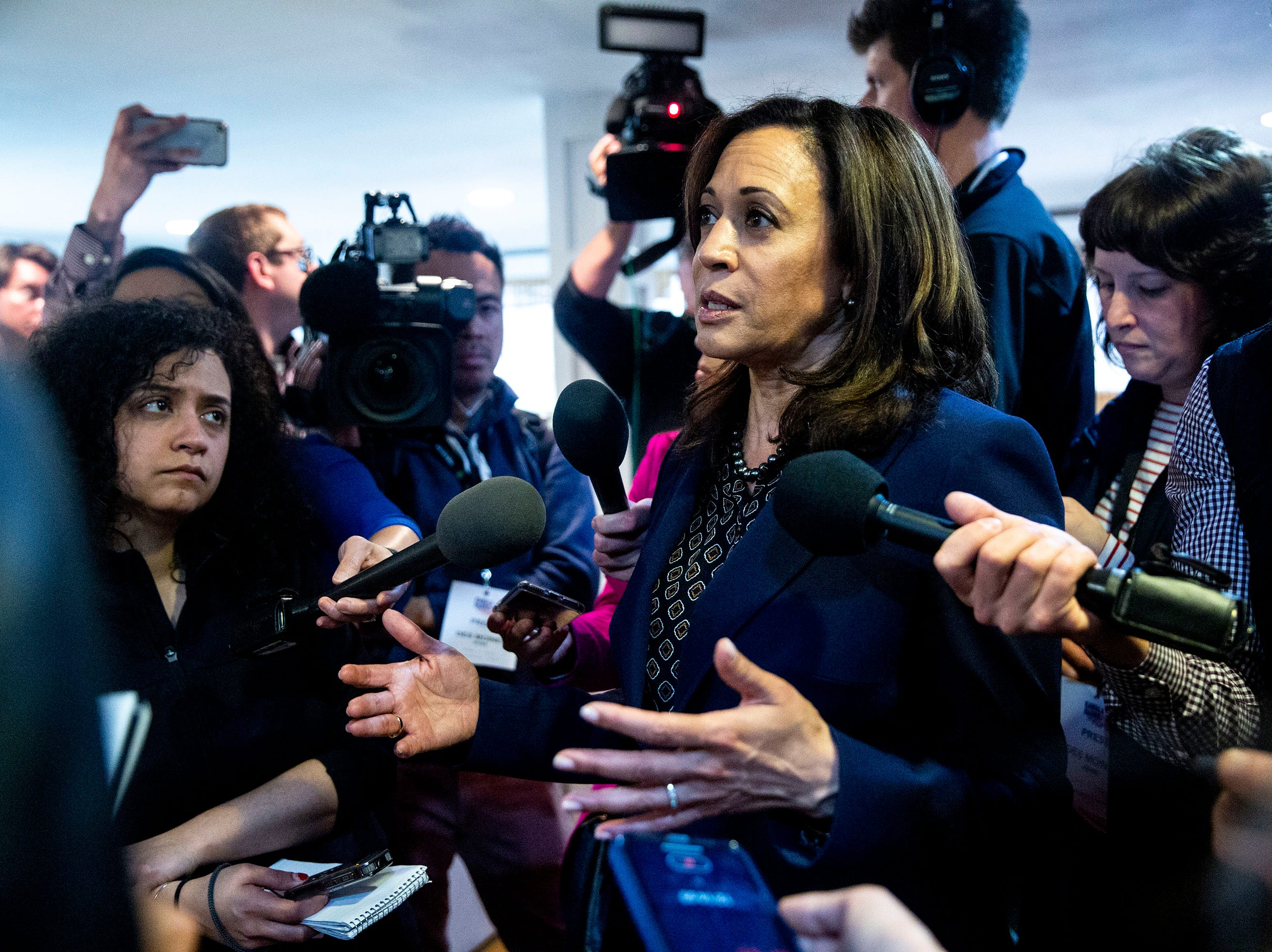 Sen. Kamala Harris, D-CA, answers questions from the press after speaking at a house party on Thursday, April 11, 2019, in Des Moines.