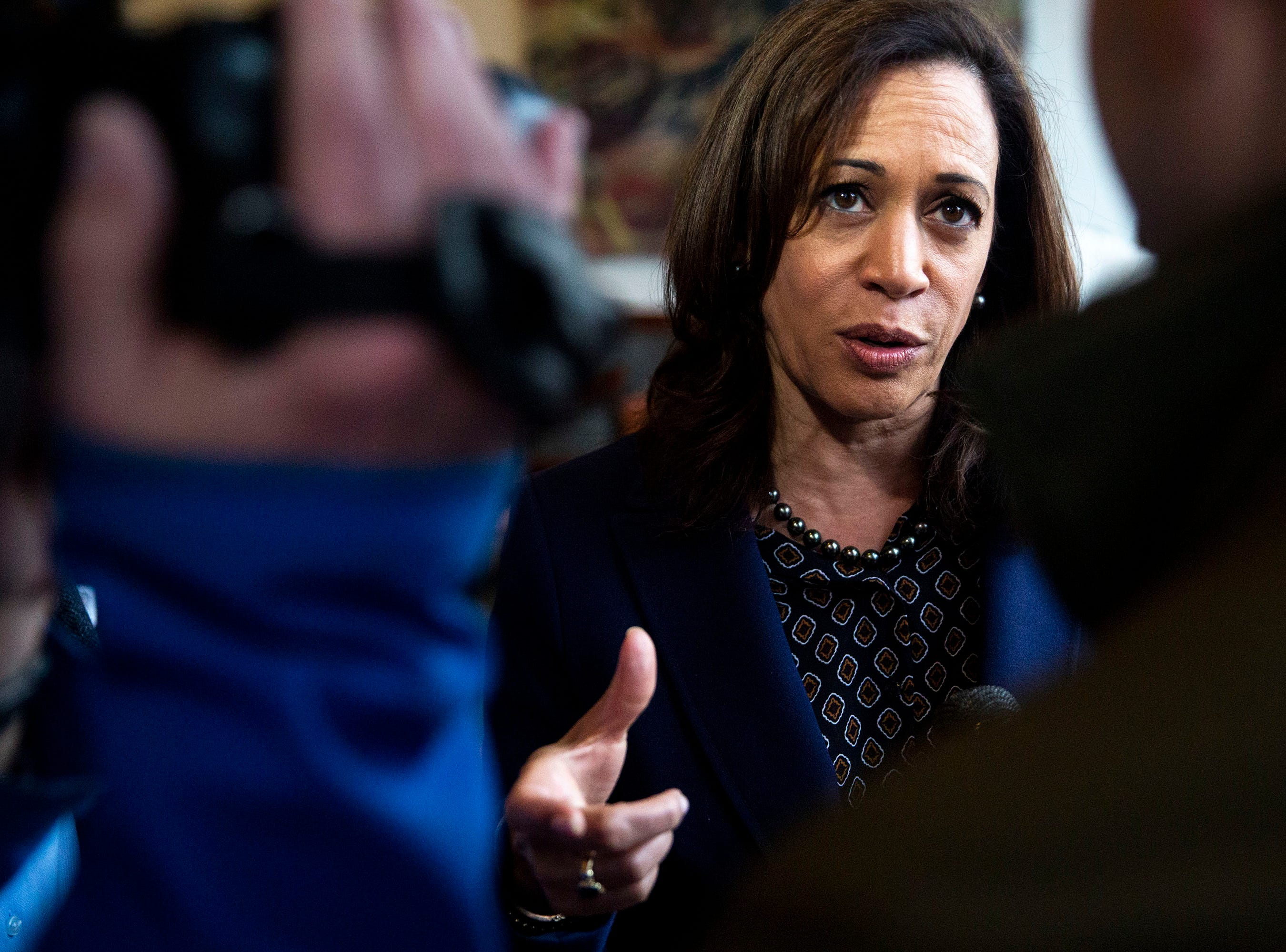 Sen. Kamala Harris, D-CA, answers questions from the press before leaving Mars Cafe on Thursday, April 11, 2019, in Des Moines' Drake neighborhood.