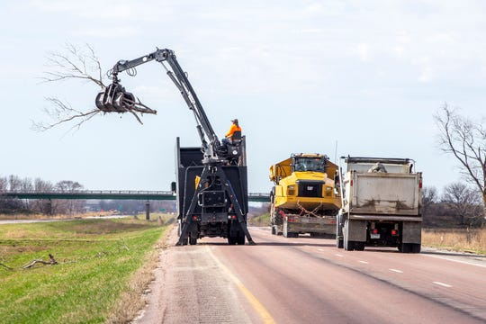 Cleanup continues on Interstate 29 between US 34 and Iowa Highway 2 as flooding begins to recede in this photo from April 9, 2019.