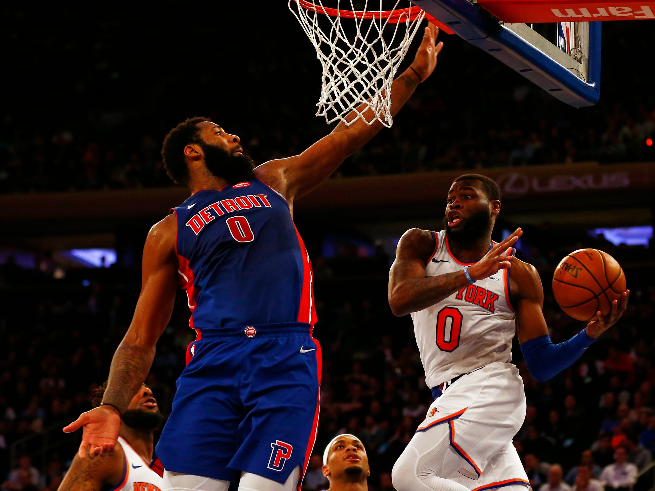 New York Knicks guard Kadeem Allen (0) looks to pass around Detroit Pistons center Andre Drummond (0) during the second half at Madison Square Garden on Wednesday, April 10, 2019.