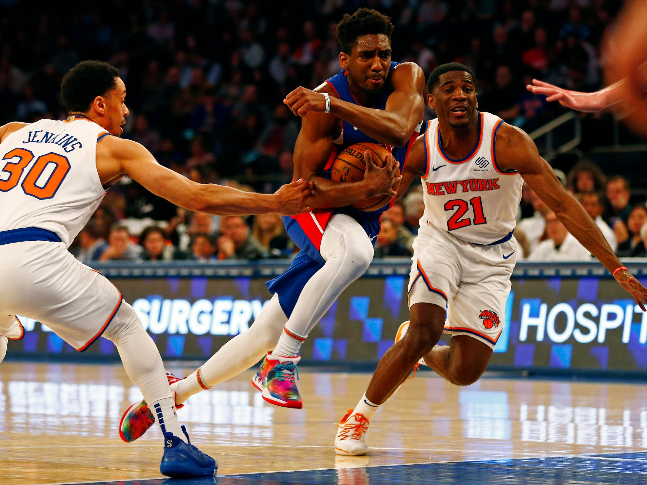 Detroit Pistons guard Langston Galloway (9) drives to the basket past New York Knicks guard John Jenkins (30) during the first half at Madison Square Garden on Wednesday, April 10, 2019.