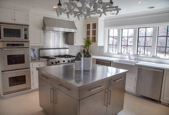 The large kitchen area in this Wallace Frost home is a true commercial kitchen, including the restaurant brand refrigerator, a Traulsen, oversize dishwashers and stainless steel counters. The owners entertained profusely and used a kitchen staff.