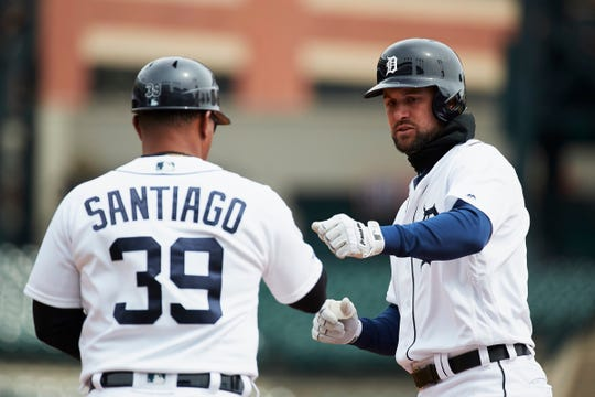 Tigers shortstop Jordy Mercer celebrates with first base coach Ramon Santiago after hitting a single in the fifth inning of the Tigers' 4-0 loss on Thursday, April 11, 2019, at Comerica Park.