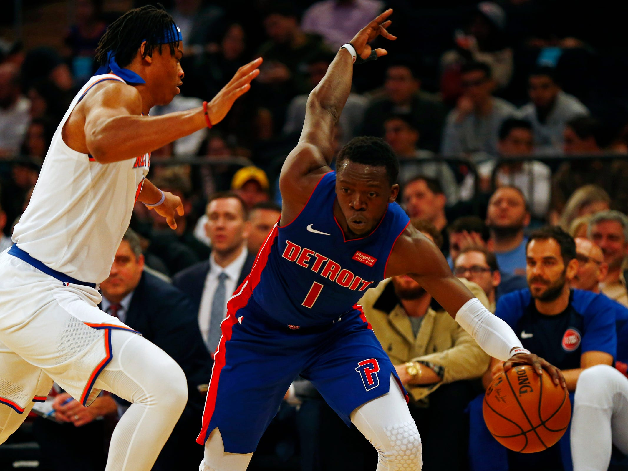 Detroit Pistons guard Reggie Jackson (1) drives to the basket past New York Knicks forward Isaiah Hicks (4) during the first half at Madison Square Garden on Wednesday, April 10, 2019.