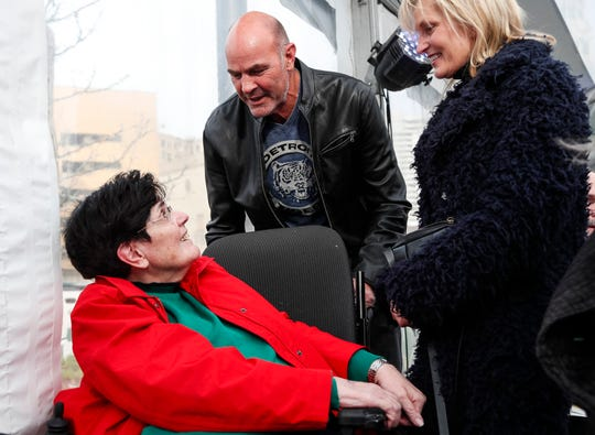 Former Detroit Free Press photographer Mary Schroeder, center, talks to former Detroit Tigers player Kirk Gibson during The Roar of '84 world premiere at Beacon Park in Detroit, Thursday, April 11, 2019.