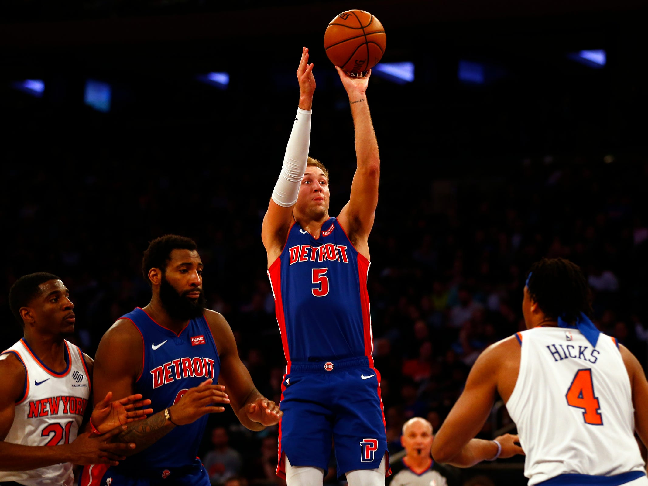Detroit Pistons guard Luke Kennard shoots over New York Knicks forward Isaiah Hicks during the first half at Madison Square Garden on Wednesday, April 10, 2019.