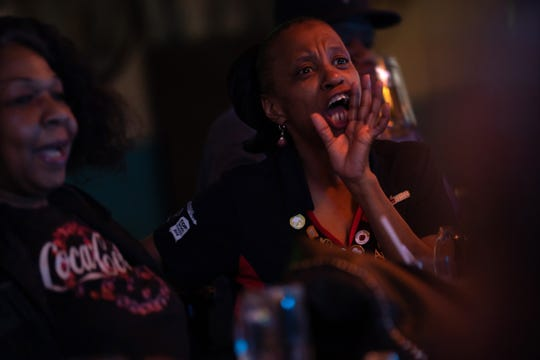 Debra Ollis, 61, shouts at the television while watching a basketball game at Hec's Bar on Friday, March 29, 2019.