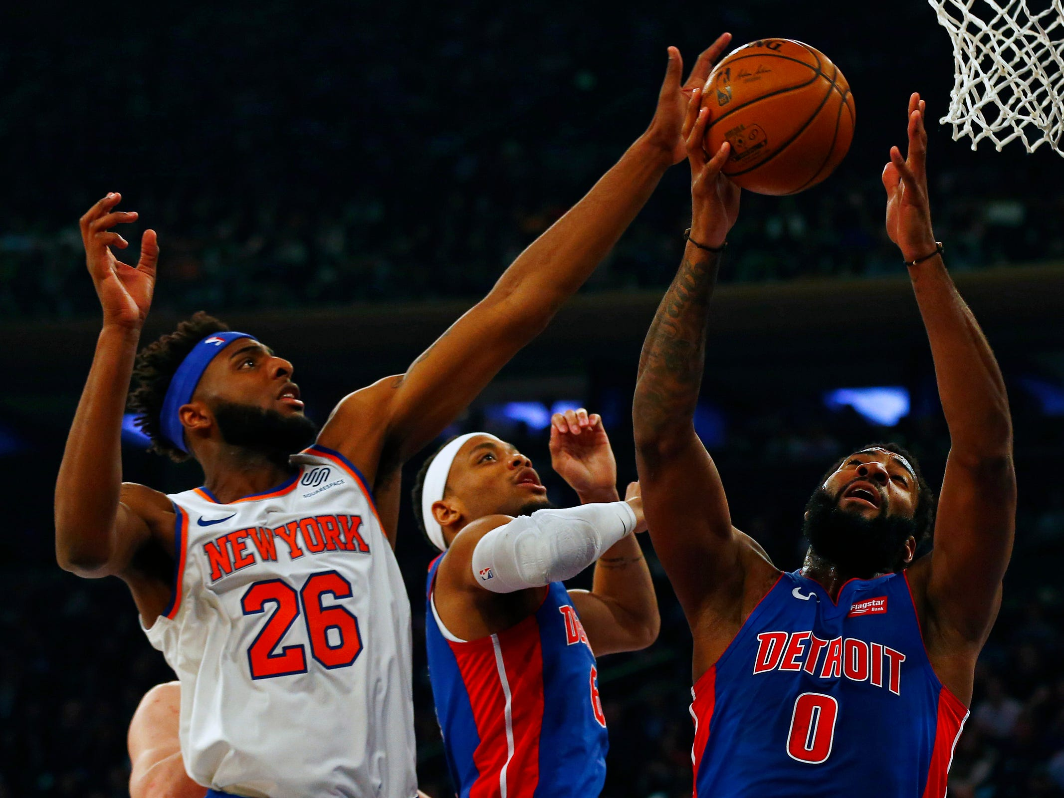 Detroit Pistons center Andre Drummond (0) grabs a rebound against New York Knicks center Mitchell Robinson (26) during the first half at Madison Square Garden on Wednesday, April 10, 2019.
