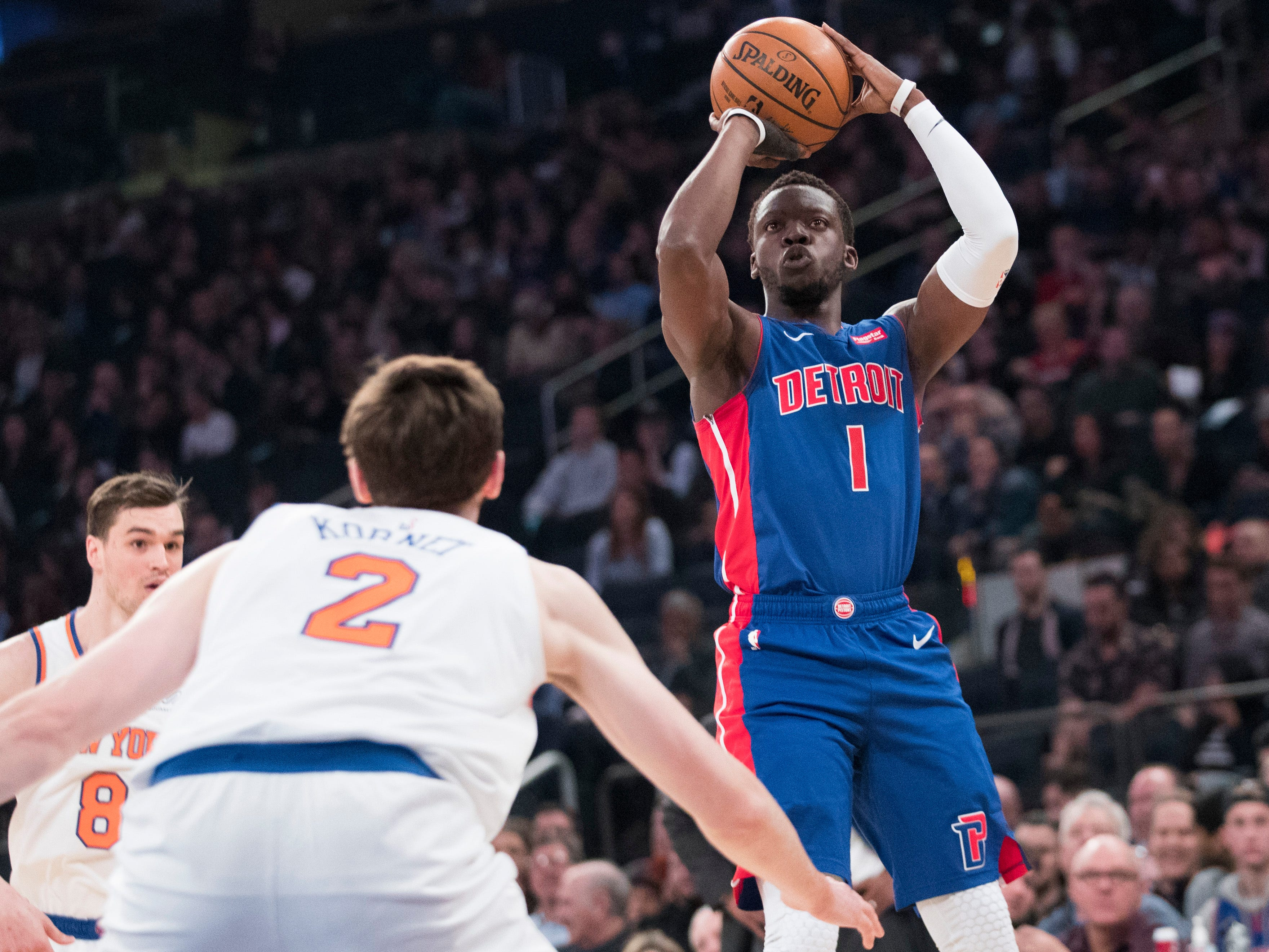 Detroit Pistons guard Reggie Jackson (1) shoots a 3-pointer over New York Knicks forward Luke Kornet (2) during the first half of an NBA basketball game Wednesday, April 10, 2019, at Madison Square Garden in New York.