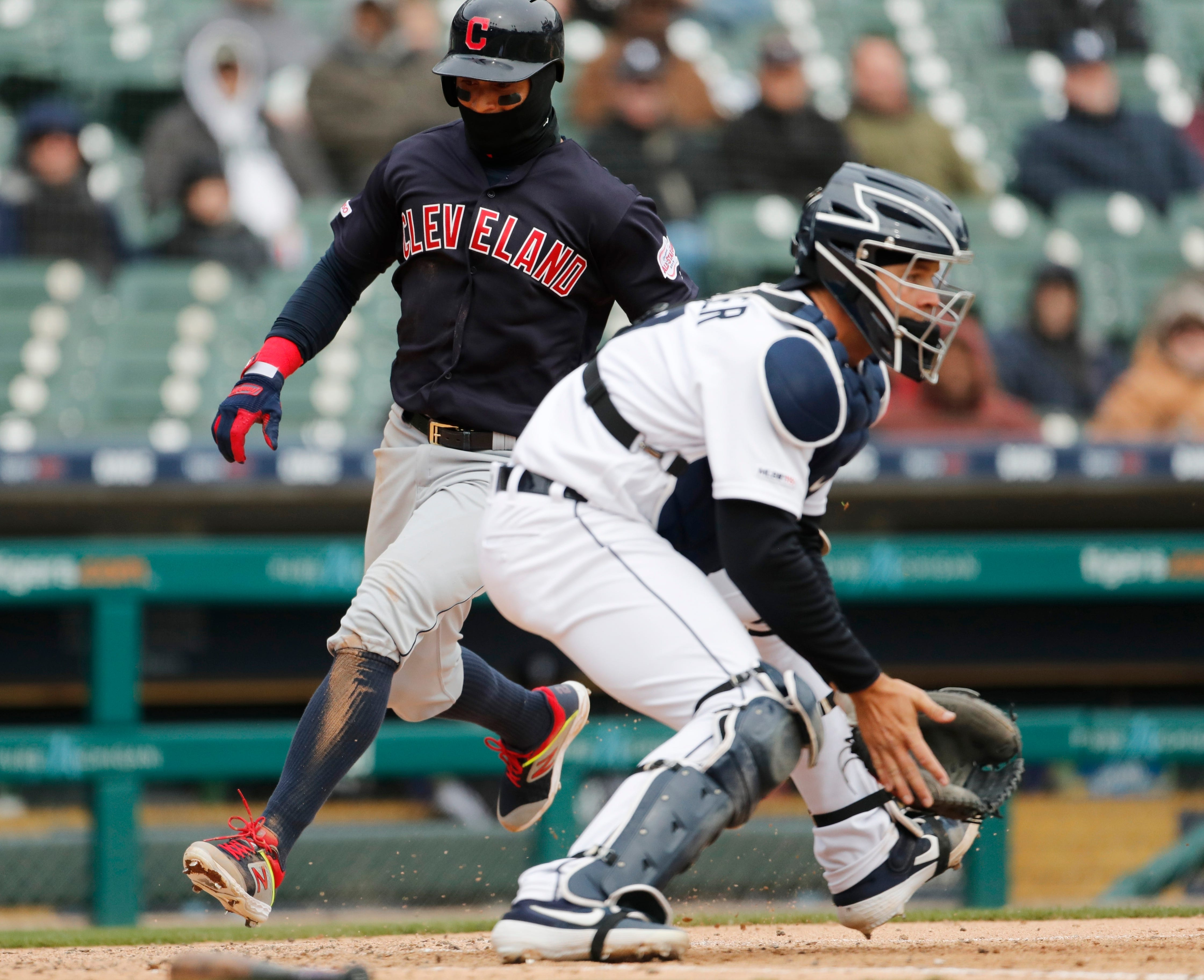 Indians center fielder Leonys Martin beats the throw to Tigers catcher Grayson Greiner to score during the seventh inning of the Tigers' 4-0 loss on Thursday, April 11, 2019, at Comerica Park.