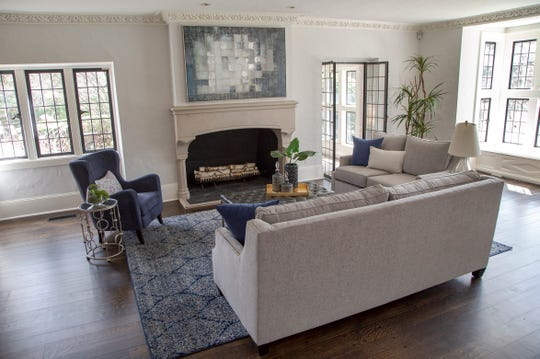 The living room at the Wallace Frost house shows the original windows and French doors, which are  mullioned with metal.  Frost emphasized windows by setting them back. Here, a deep setback makes room for a window seat.