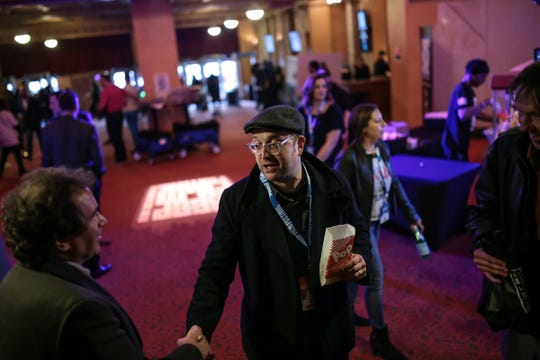 Director Scott Crawford (center) talks with Josh Bassett of Farmington Hills during the opening night of the Freep Film Festival at the Fillmore Detroit in downtown Detroit on Wednesday, April 10, 2019.