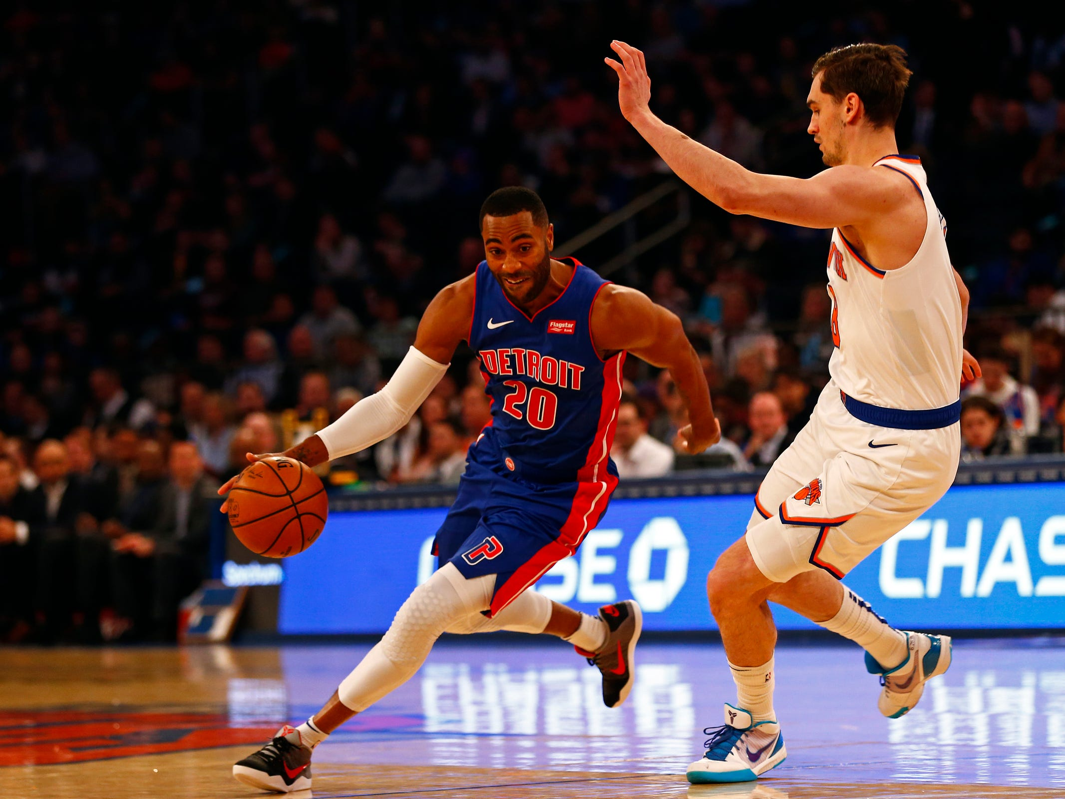 Detroit Pistons guard Wayne Ellington (20) drives to the basket past New York Knicks forward Mario Hezonja (8) during the first half at Madison Square Garden on Wednesday, April 10, 2019.