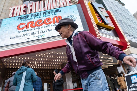 """Duane Smelser of Ira Township dances before the showing of """"Boy Howdy: The Story of Creem Magazine"""" during the opening night of the Freep Film Festival at the Fillmore Theatre in downtown Detroit on Wednesday, April 10, 2019."""