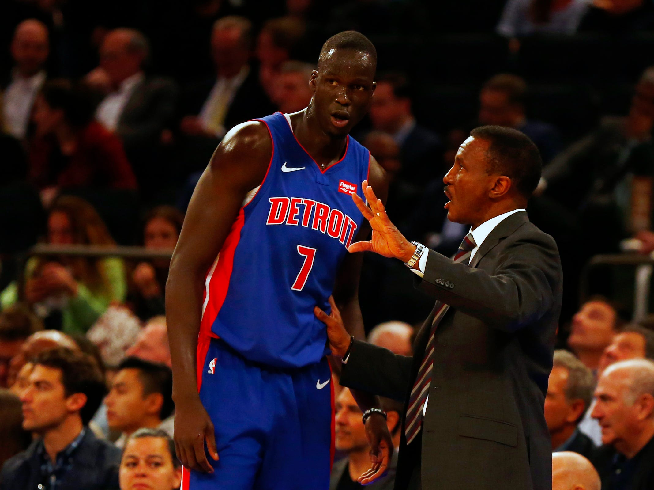 Detroit Pistons head coach Dwane Casey talks with Detroit Pistons forward Thon Maker (7) against the New York Knicks during the first half at Madison Square Garden on Wednesday, April 10, 2019.