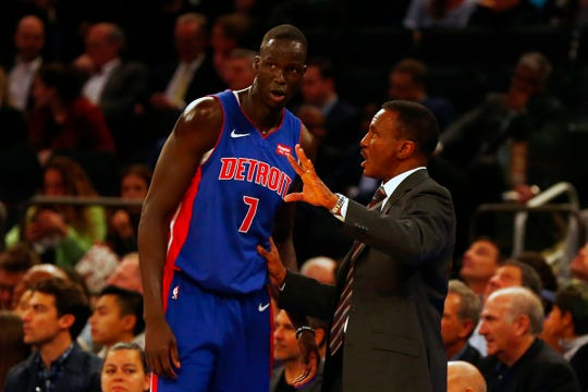 Pistons coach Dwane Casey talks with Thon Maker at Madison Square Garden on Wednesday.