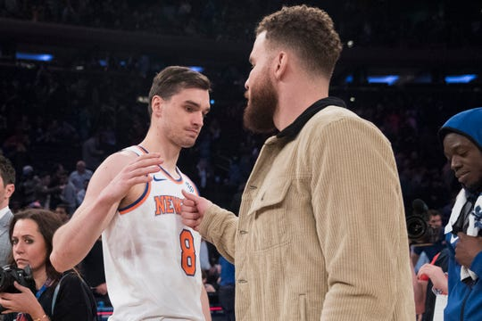 New York Knicks forward Mario Hezonja (8) greets Detroit Pistons forward Blake Griffin at the end of an NBA basketball game Wednesday, April 10, 2019, at Madison Square Garden in New York. The Pistons won 115-89.