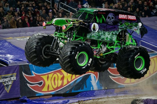 Grave Digger, one of the trucks slated to be at Cedar Point, gets some air at Monster Jam 2018 at Ford Field in Detroit.