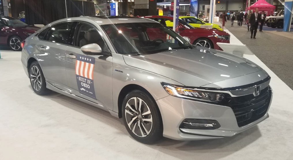 Foreign-owned brands like Honda are labeling cars on display at the Washington Auto Show with signs that highlight their assembly at U.S. auto plants.