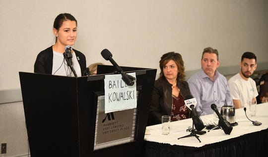 Michigan State University student Bailey Kowalski, 22, with her mother Robin Kowalski, father David Kowalski and brother Hunter Kowalski looking on, speaks during a press conference in East Lansing.