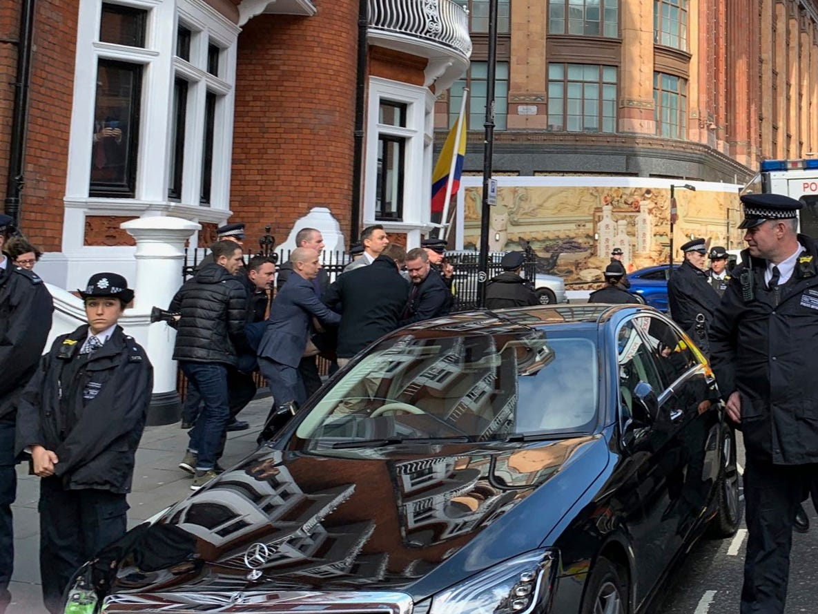 Police carry WikiLeaks founder Julian Assange from the Ecuadorian embassy in London after he was arrested by officers from the Metropolitan Police and taken into custody Thursday April 11, 2019. Police in London arrested WikiLeaks founder Assange at the Ecuadorean embassy Thursday, April 11, 2019 for failing to surrender to the court in 2012, shortly after the South American nation revoked his asylum.