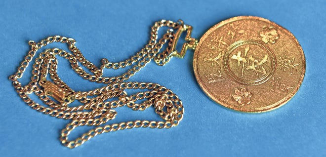 This is a 23-karat Chinese gold medallion owned by Barbara Malburg.