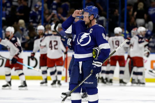 Tampa Bay Lightning center Steven Stamkos (91) skates off as the Columbus Blue Jackets celebrate their 4-3 win during Game 1.