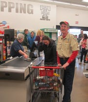 Boy Scout leader Rick Evans is learning the value of the groceries he gathered up in a recent three-minute shopping spree at Trumansburg Shur-Save. Evans donated the $195 worth of groceries to the Hector Presbyterian Church food pantry.