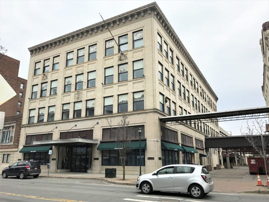 An Ithaca developer has purchased the former Iszard's department store building on North Main Street in Elmira.