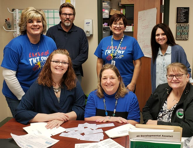 Staff members supported April's Child Abuse and Neglect Prevention Awareness Month by wearing blue. Left to right in front are Front Row: Ashley Walterbusch, Connie Cornett, and Brenda Lochotzki. In back are Melissa Antry, Mark Cuthbertson, Annette Nordlund and Paula Adkins.