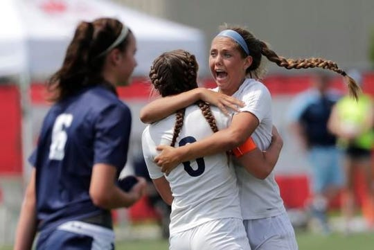 Bay Port's Emma Nagel (1) celebrates scoring a goal during the state title game against Sheboygan North in June.
