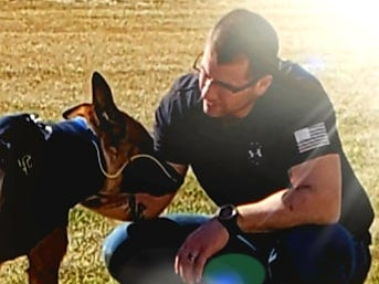 Pyro, a Green Bay police dog, and his handler, officer Scott Salzmann.