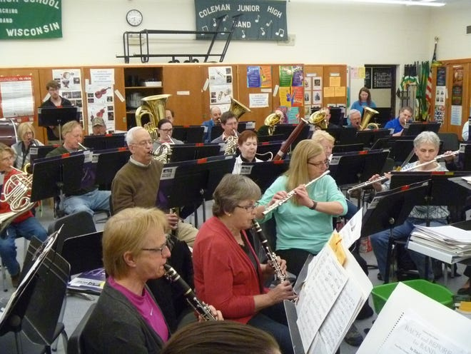 Members of the Northeastern Wisconsin Concert Band rehearse in the band room at Coleman High School, Coleman, in preparation for the band's Spring Concert on May 5.