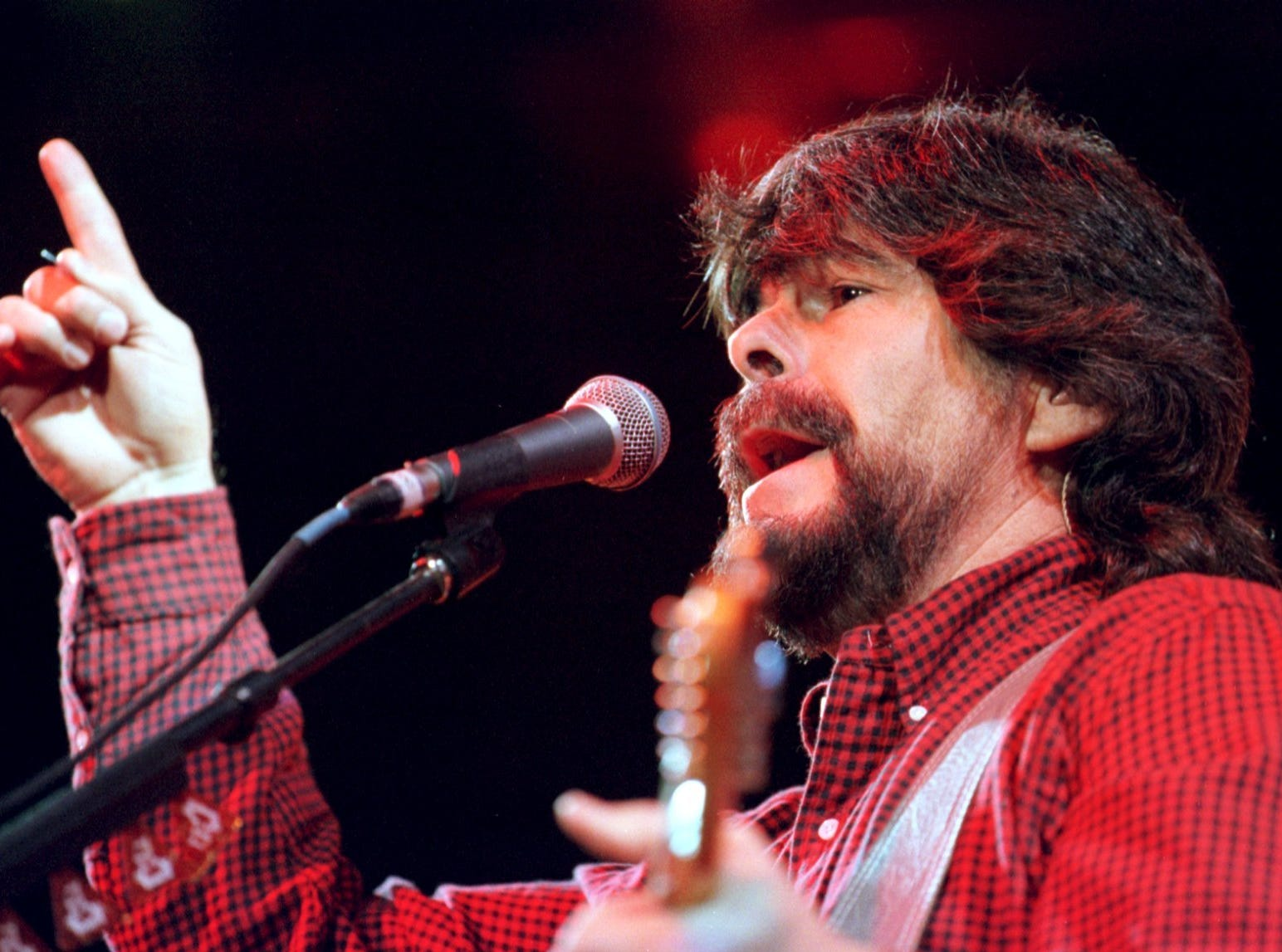Randy Owen, lead singer for the country group Alabama, gets the crowd going early in the band's performance during a 1998 show at Brown County Veterans Memorial Arena.