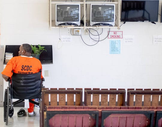 An SCDC inmate stops in front of the TV area at Kirkland Correctional Institution Thursday March 14, 2019, in Columbia, SC.