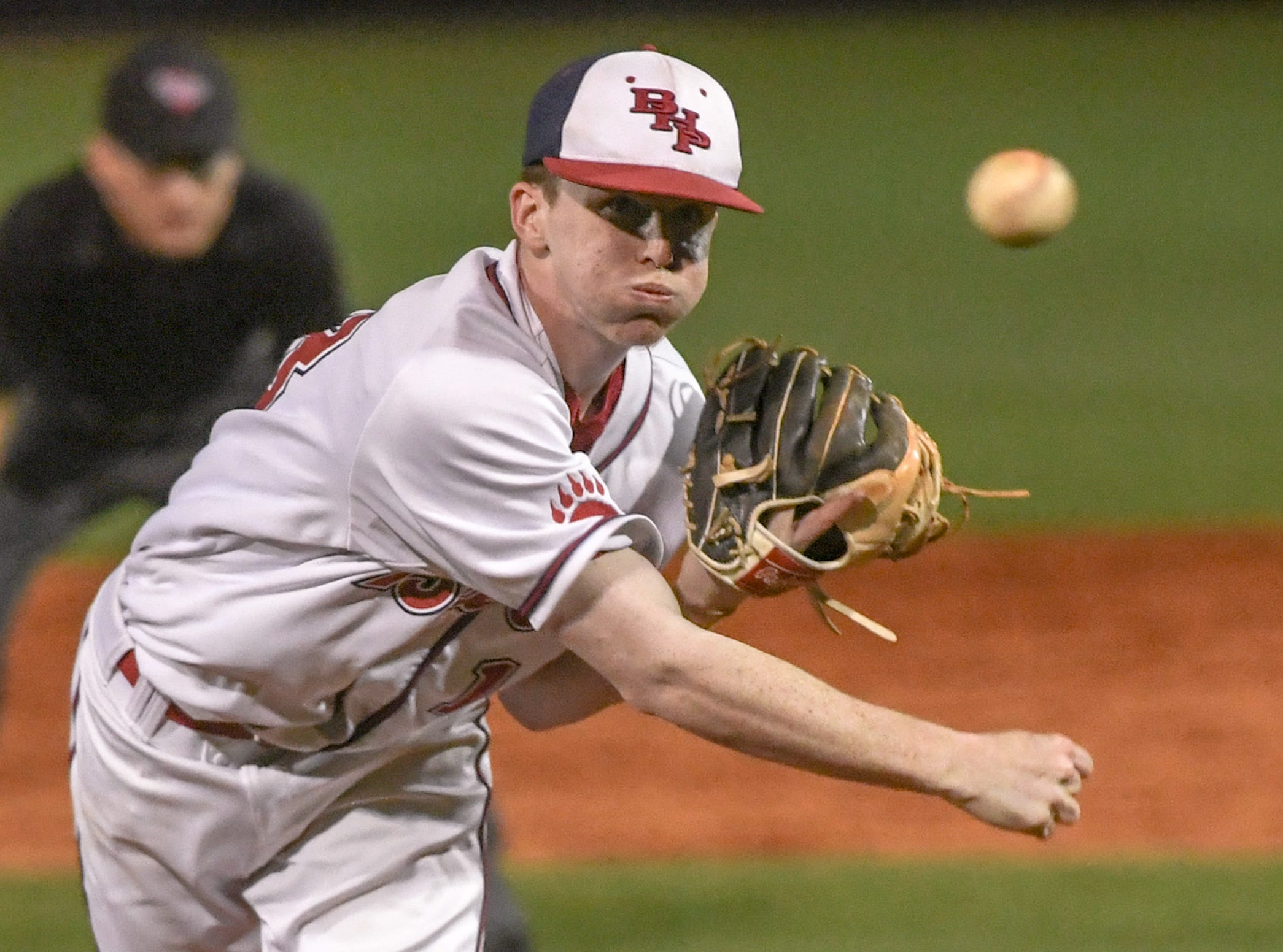 Belton-Honea Path senior Landon Gaddis (18) throws the final pitch against Wren to end the top of the seventh inning at Belton-Honea Path High School in Honea Path Wednesday, April 10, 2019.  BHP won 7-5 and the Class AAAA Region 1 title.