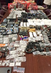 Cell phones and other contraband are displayed after being seized in a single raid at Lee Correctional Institution in 2016.