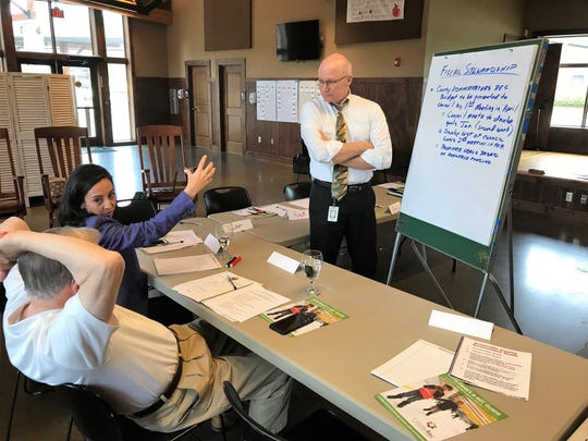 Greenville County Council member Liz Seman, center, talks to Councilman Willis Meadows, left, and Deputy County Administrator John Hansley about strategies for fiscal stewardship of county government at a council retreat Thursday, April 11, 2019 at Pleasant Ridge County Park.