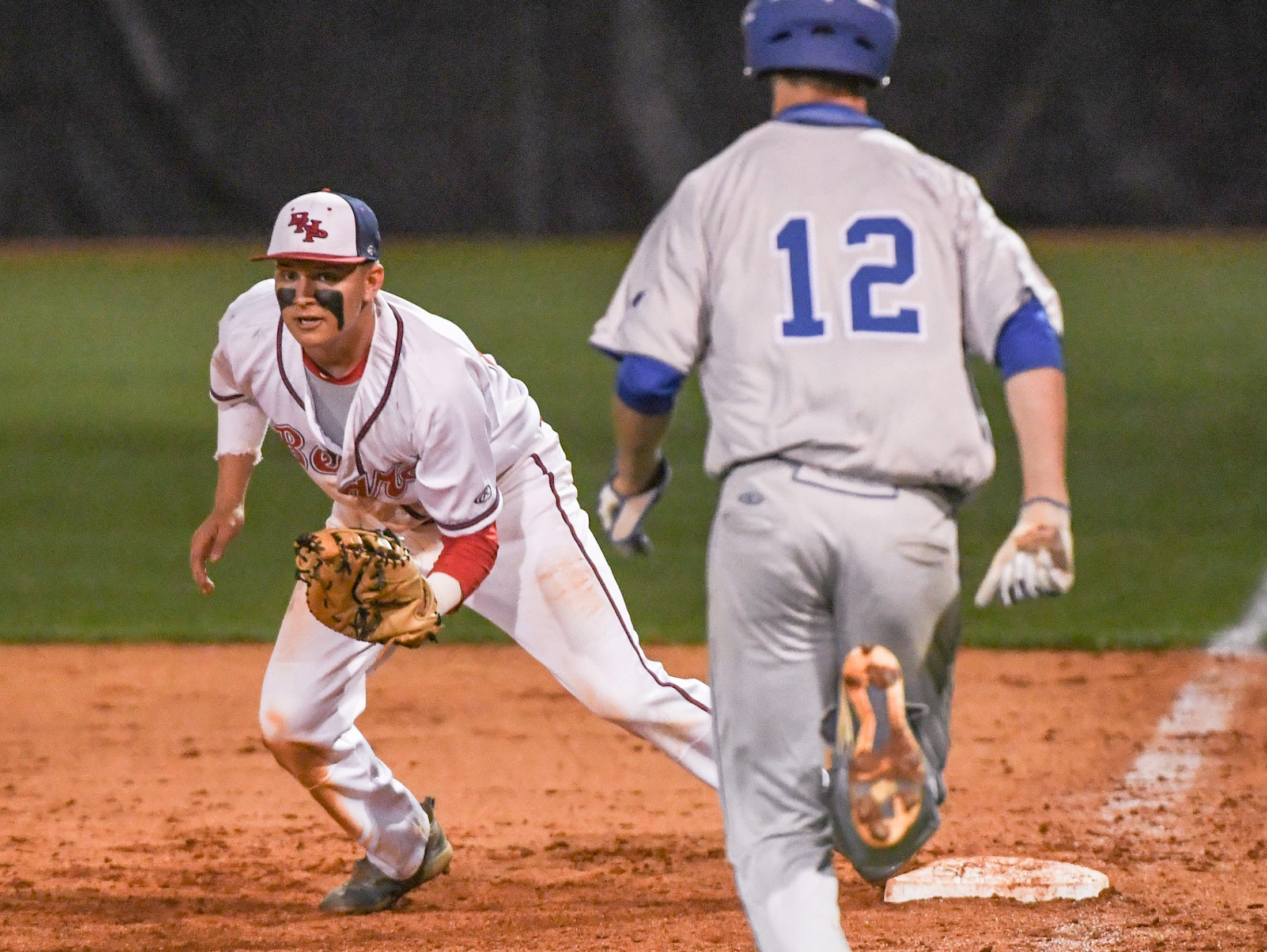 Belton-Honea Path senior Josh Davis (14) clutches  end the top of the seventh inning at Belton-Honea Path High School in Honea Path Wednesday, April 10, 2019.  BHP won 7-5 and the Class AAAA Region 1 title.
