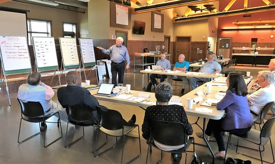 Frank Crawford, standing, with the management consulting firm Resource Development Associates leads a morning session at a Greenville County Council retreat Thursday, April 11, 2019 at Pleasant Ridge County Park to determine the county's goals in coming years.
