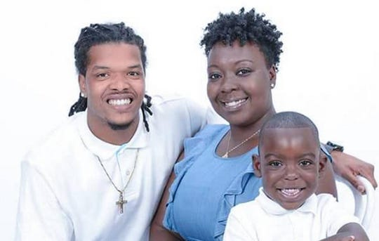 Sinetra Geter-Johnson poses for a family photo with her husband, Jah Johnson, and son Kamrin in 2017.