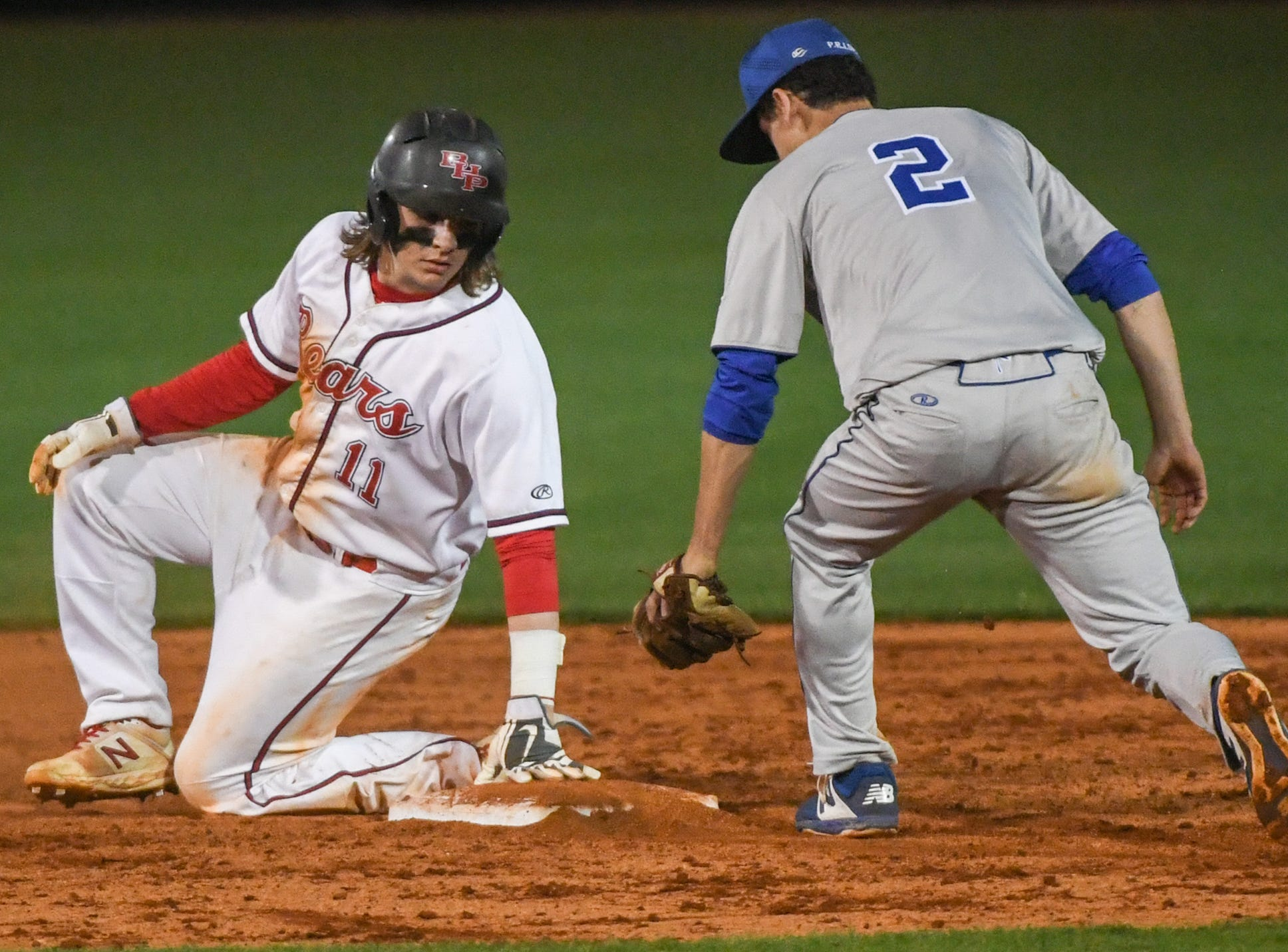 Wren secondbaseman Boyd Gambrell (2) sees Belton-Honea Path senior Braden Galloway (11) safely at second base during the bottom of the sixth inning at Belton-Honea Path High School in Honea Path Wednesday, April 10, 2019.