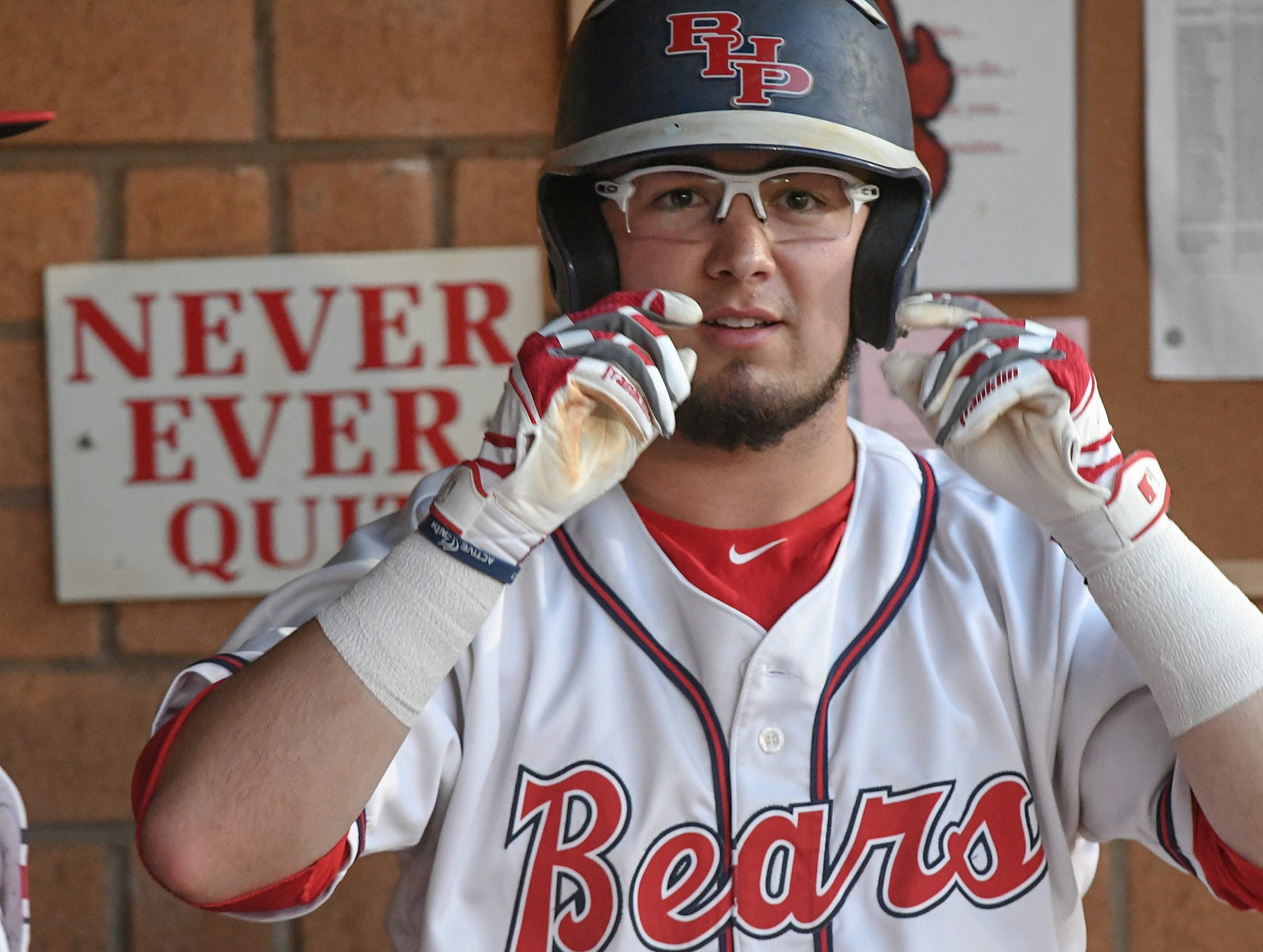Belton-Honea Path senior Tyliss Roper (10) adjusts his glasses in the dugout before hitting against Wren during the top of the fifth inning at Belton-Honea Path High School in Honea Path Wednesday, April 10, 2019.