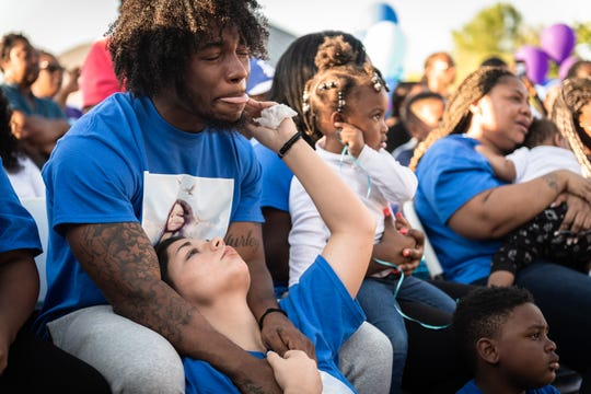 Jaquan Hicks, Trinity Harrison's brother, cries with his girlfriend Justice Gambrell, at a vigil in the memory of 18-year-old Harrison took place at Uptown Market in Greenwood Wednesday, Apr. 10, 2019. Harrison was killed when a drunk driver collided with the vehicle she was riding in with her prom date on U.S 25 South on Saturday, Apr. 6