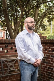 Andy Arnold, of Greenville on his back patio, Apr. 11, 2019. Arnold uses CBD products to alleviate neck pain he has experienced to varying degrees for about ten years, the most intense periods of pain beginning last January. Arnold discovered that CBD products relieved his neck pain while using them without success to treat anxiety.
