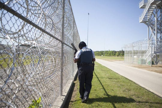 A South Carolina Department of Corrections officer patrols outside of Lee Correctional Institution in Bishopville, S.C.