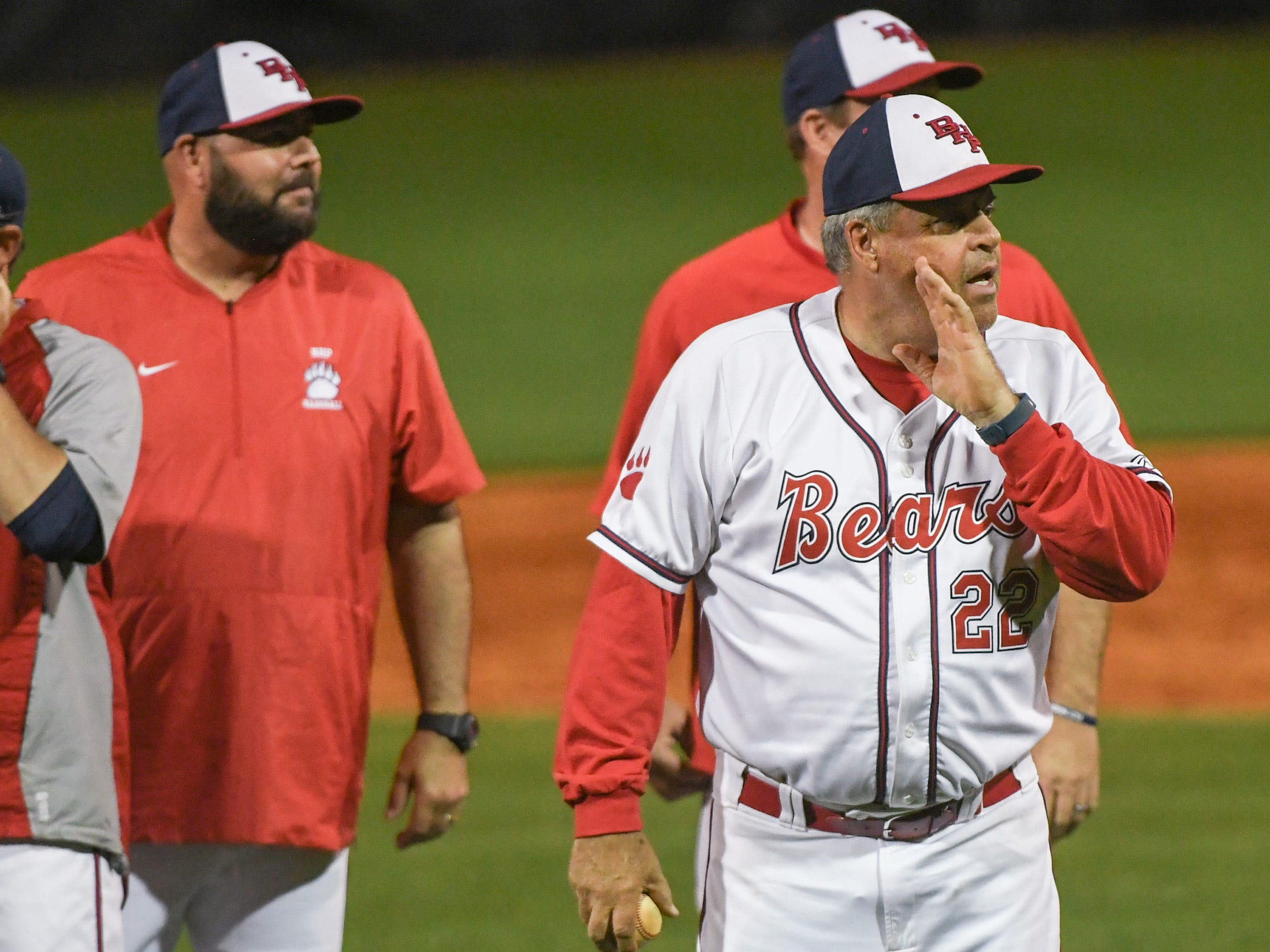 Belton-Honea Path head coach Steve Williams, right, after BHP beat Wren 7-5 to claim the Class AAAA Region 1 title.