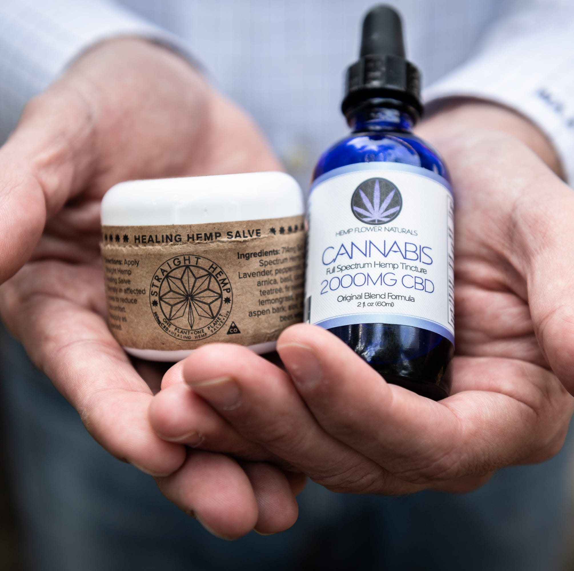 CBD oil products abound, but do they really work? Some say yes while experts urge caution