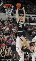Caleb Bellach led Manhattan Christian to the State C championship.