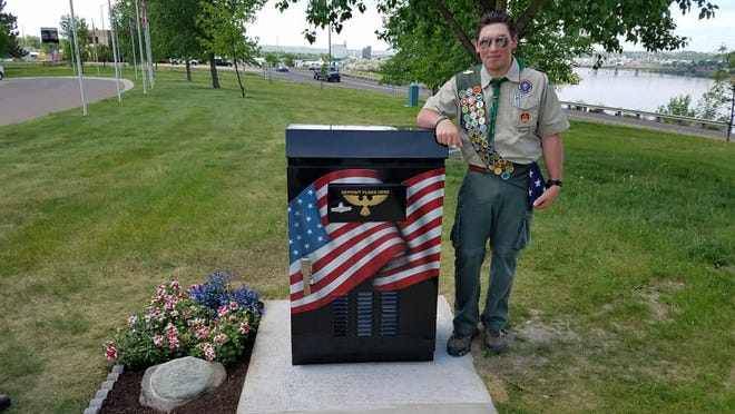 Sean Lynch supervised improvements to the Montana Veterans' Memorial. Volunteers assisted with the installation of the box as a receptacle for worn flags (dedicated to Veterans) and planted flowers at the memorial. The worn flags are properly retired.